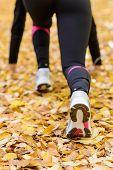 stock photo of leggins  - Sport woman in ready to run pose - JPG