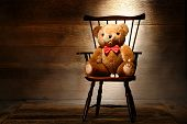 Vintage Teddy Bear Toy On Chair In Old House Attic