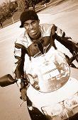 Biker With Backwards Black Hat Grins
