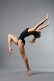 picture of ballet dancer  - young beautiful ballerina posing on grey background - JPG