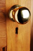 Wooden Door With Old Fashioned Brass Doorknob And Keyhole