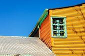 Orange Building And Blue Sky