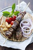 greek style pita bread with meat skewers (souvlaki)