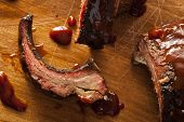 stock photo of spare  - Smoked Barbecue Pork Spare Ribs with Sauce - JPG