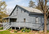Grey Siding House With Wheelchair Ramp