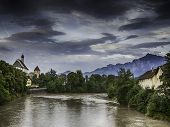 River Lech In Fussen With Historic Church And Alps