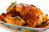 stock photo of chicken  - Roasted chicken and vegetables on white background - JPG