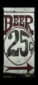 Old weather beaten sign advertising 25 cent beer
