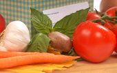 Recipe box and the ingredients for fresh spaghetti and sauce