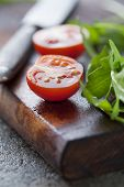 fresh rocket and tomatoes on a wooden chopping board