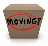 stock photo of movers  - The word Moving on a cardboard box to illustrate relocation assistance service such as logistics and movers - JPG