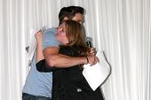 LOS ANGELES - AUG 25:  Daniel Goddard, Fan doing a scene from a YnR script at the Goddard and Khalil