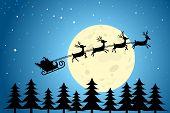 Santa And Reindeer Flying Through The Night Sky
