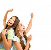 Happy and Laughing Teenage Girls Dancing. Hands up. Beauty Teenagers Having Fun together. Girlfriend