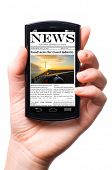 mobile phone in hand with news on touch screen, isolated on white