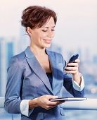 Closeup portrait of pretty young woman calling to business partner, beautiful executive manager, goo