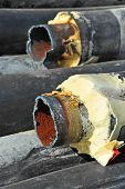 Rusty steel pipe with heat insulation