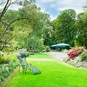 Beautiful Summer Park With Green Lawns And Flower Beds