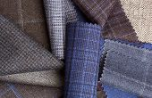 Set Of Colorful Wool Fabric Textiles To Background