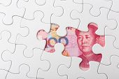 foto of yuan  - Chinese yuan and puzzle piece - JPG