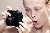 Woman photographer pulling a comical face