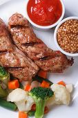 Grilled Sausage With Vegetables, Ketchup And Dijon Mustard.
