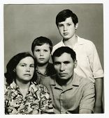 KURSK, USSR - CIRCA 1970:  An antique photo shows  portrait of a Soviet family - father, mother and two sons.