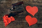 Creative love concept, ironing wrinkled hearts on a beautiful old table.