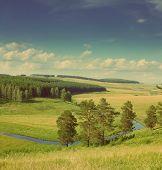 hills summer landscape in Russia Ural - vintage retro style