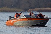KIEV, UKRAINE -NOV 3: Ukrainian Civil Protection lifeboat during historical reenactment of WWII, Dnepr river crossing 1943, November 3, 2013 . Kiev, Ukraine