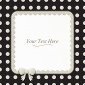 stock photo of girlie  - A cute black and white polka dot square frame accented with a small white bow and lace - JPG