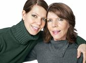 Happy mature woman portrait together with adult daughter
