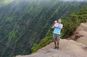 Father And His Baby In Kauai, Hawaiian Islands