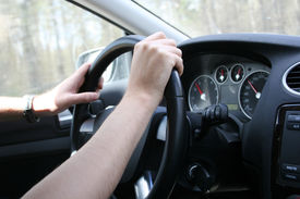picture of driving school  - Driver man holds a steering wheel of his car - JPG