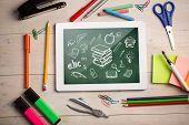 Composite image of digital tablet on students desk showing school doodles