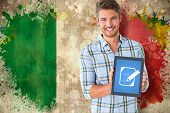 Young student showing tablet pc against grunge italy flag