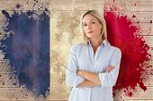 Mature student frowning against france flag in grunge effect