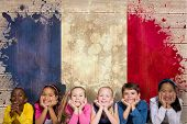 Cute pupils smiling at camera against france flag in grunge effect