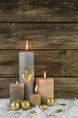Traditional Christmas Decoration With Four Beige Burning Advent Candles On Wooden Background.