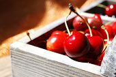 Fresh cherries in wooden box, close up