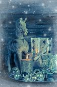 Shabby Chic Christmas Decoration In Silver With Wooden Horse, Candle And Present.