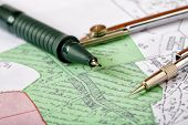 Topographic Map Of District With A Measuring Instrument And Pencils