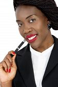 Attractive Business Woman Smiling with Pen in Hand, Closeup, On White Background