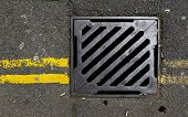 Sewer Cover With Double Yellow Lines