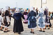Amateurs In National Dresses Dancing Breton Dance