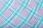 Purple and turquoise blue plaid print as background.
