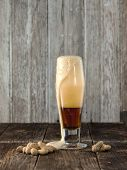 Frothy Beer And Peanuts.