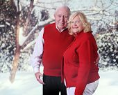A loving senior couple outside in a wintery world.
