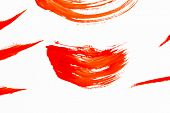 Abstract smears of orange paint on white background