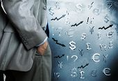 Bottom view of businessman and currency signs at background